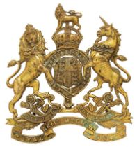 Royal Army Medical Corps Officer helmet plate circa 1901-14. Gilt die-stamped Royal Arms, pierced