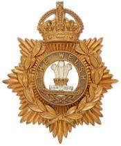 Welsh Regiment helmet plate circa 1901-14. Good die-stamped brass crowned star bearing laurel sprays