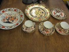 A quantity of mixed Royal Crown Derby plates and cups together with a 19th century dish