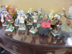 A set of nine Will Young Widecombe Fair novelty pottery figures to include Bill Brewer and other