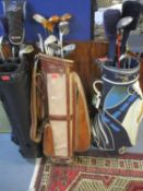 Three golf bags to include Wilson and contents to include various golf clubs comprising Tourney,