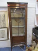 An early 20th century mahogany glazed display cabinet with internal shelves, 168 x 65cm