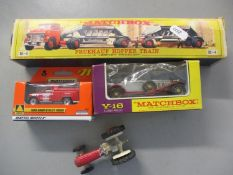 A Matchbox Fruehauf Hopper Train in original box by Lesney together with two later Matchbox vehicles
