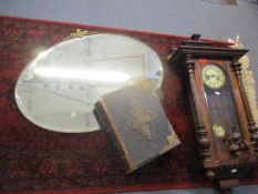 A mahogany cased wall clock, a Rev. John Eadie family bible and a metal framed and oval wall mirror