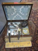 A rosewood jewellery box and contents to include watches and costume jewellery and other items