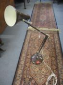 A mid 20th century dark brown anglepoise lamp