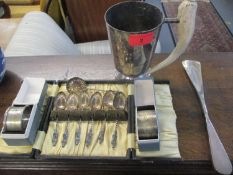 A group of silver and silver plated items to include two cased napkin rings and a cased set of