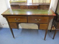 An Edwardian mahogany inlaid ladies desk with raised back, green leather scriber and tapering