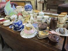 Mixed vintage household china to include tea cups with saucers, models of animals to include a