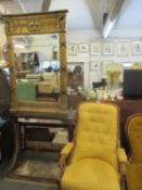 A gilt and black painted console table and matching Empire style mirror above a black marble