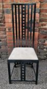 An Arts and Crafts style dining chair after Charles Rennie Mackintosh, in the 'Hill House' style,
