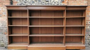 An early 20th century string inlay mahogany breakfront bookcase by P.E Gane, the top with