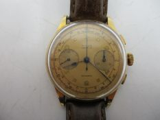 A Titus chronograph 18ct gents manual wind wristwatch circa 1950's. The dial having blued hands