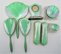 An Art Deco eight piece silver and enamel dressing table set, of which five pieces are by James