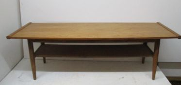 A Modern Design Long John coffee table, of rectangular shape with widened centre, above a shelf,