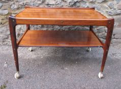 A mid century Modern Design hardwood tea trolley, of Danish style, with rounded edges on tapered