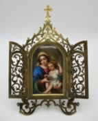 A 19th century devotional, with central painted porcelain plaque depicting the 'Madonna of the
