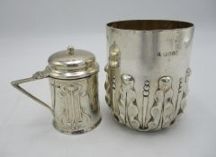 An Edward VII silver mustard pot by Roberts & Belk, in the Art Nouveau style with embossed