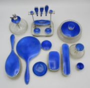 An Art Deco period silver and blue enamel mixed dressing table set, by Albert Carter and William