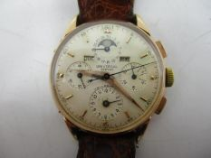 A Universal 18ct Gold Triple Calendar Chronograph Moonphase Wristwatch, circa 1940s. The silvered