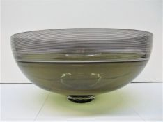 A Mid century Continental glass punch bowl, with thin black striped border and smoky body, signed