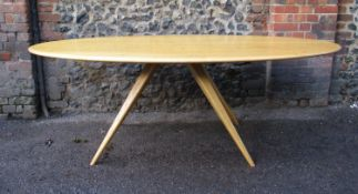 A Modern Design light oak dining table by Benchmark Furniture, of oblong form supported on four