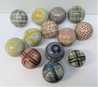 A group of thirteen Victorian Scottish ceramic carpet bowls, with colourful tartan and striped