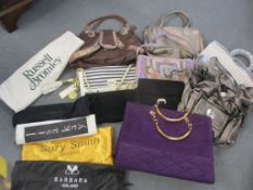 A Jane Shilton purple suede handbag with gold tone hardware, an Abro black suede clutch bag and