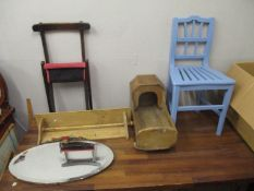 Small furniture to include an early 20th century pine doll's crib, a pine rack, a barbola mirror and