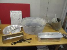 Metalware to include a fish kettle, a watering can, a French spoon rack, a clothes airer maid