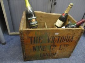 A wooden wine crate and three bottles to include half bottle of Moet & Chandon Champagne