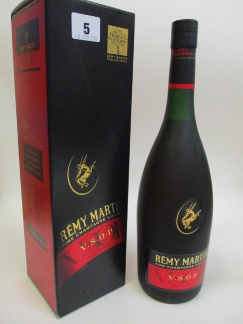 A bottle of Remy Martin Champagne Cognac, l litre, boxed
