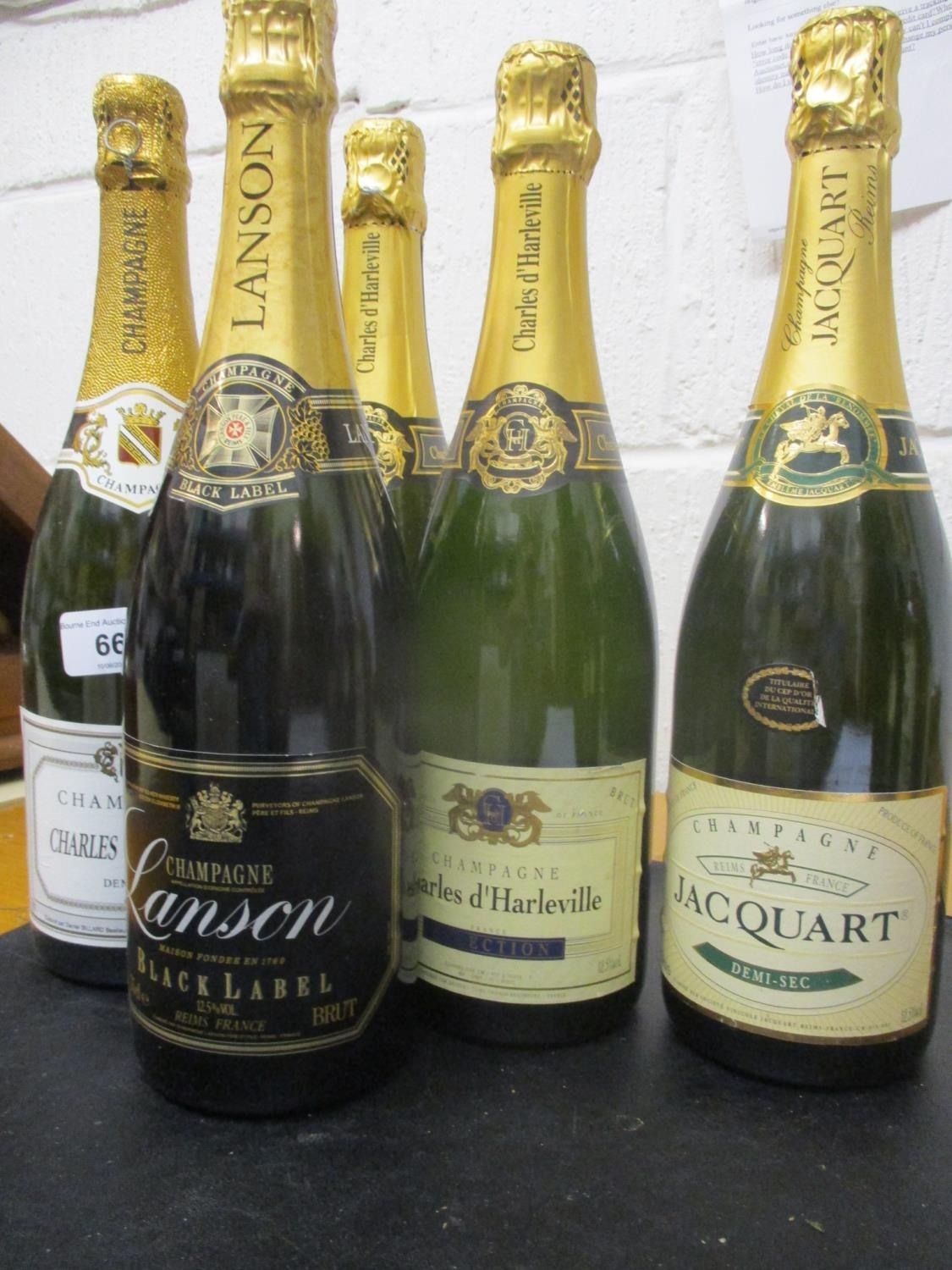 Five bottles of Champagne to include Lanson Black Label, Charles du Plaisir Jacquart and Charles d'