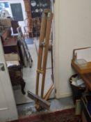 A folding artist's beech easel Location: G