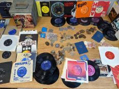 A quantity of 1950s/60s records to include Beatles, along with a collection of coins and