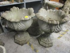A pair of stoneware garden planters raised on octagonal shaped bases, 60 h x 51cm w Location: G