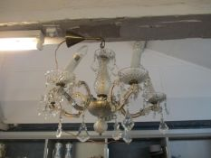 A brass and pressed glass five branch chandelier Location: SLCeiling