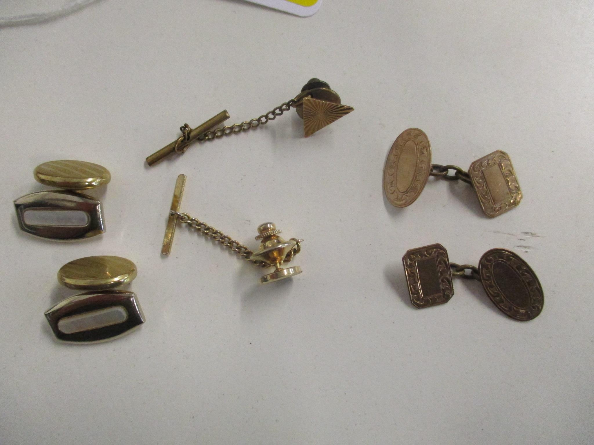 A pair of 9ct gold Chester hallmarked cuff links, 5.4g, along with other cuff links