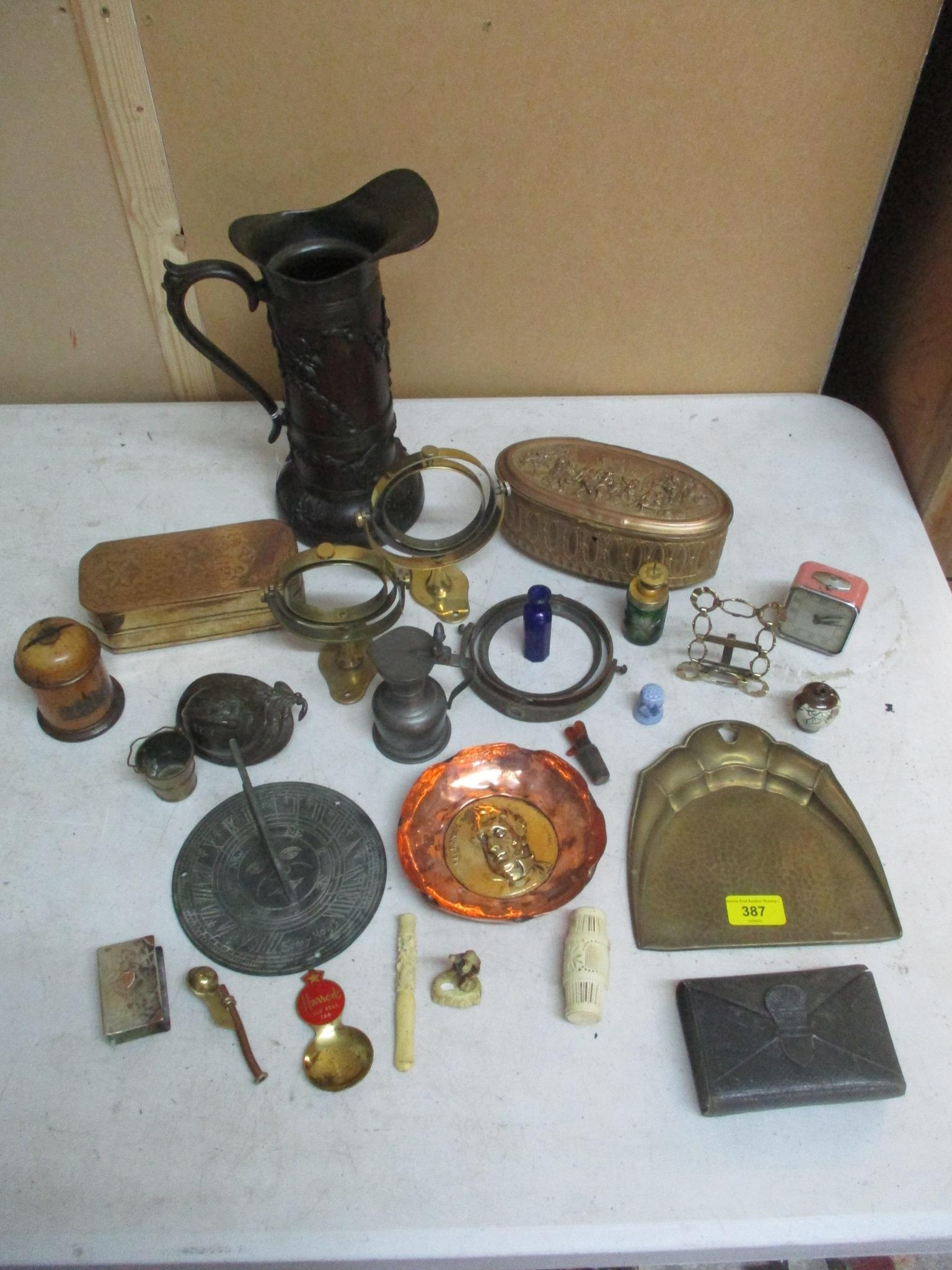 An interesting mixed lot o include a brass sundial, gilt metal and brass boxes and other items