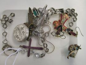 A selection of costume jewellery to include a silver and enamelled pendant cross on chain, a