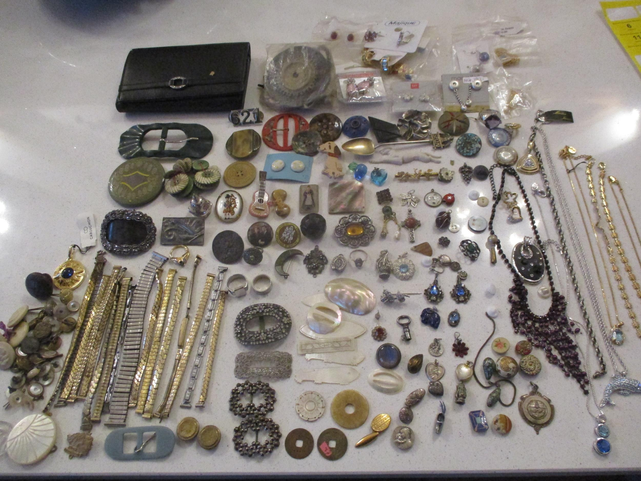 An interesting lot to include shoe buckles, silver coloured and white metal pendants, brooches,