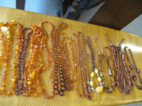 A quantity of amber, amber style and vintage necklaces Location: Cab