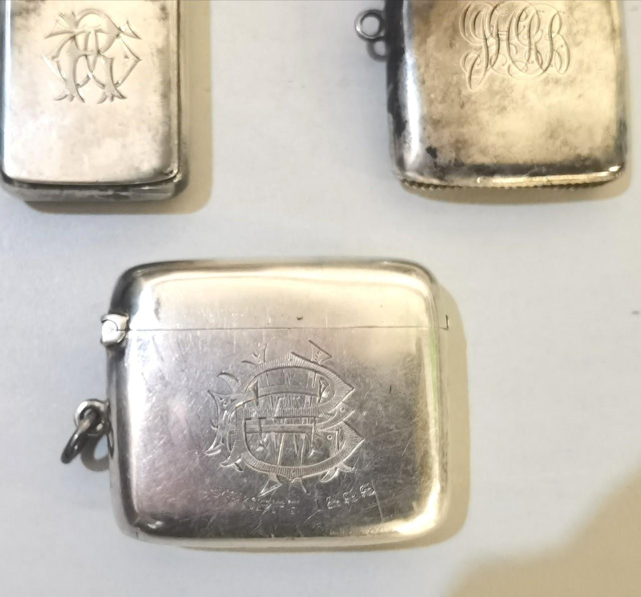 A group of three Victorian silver vesta cases having engraved motifs together with a Victorian - Image 2 of 3