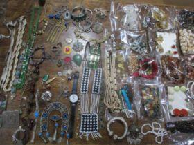 Costume jewellery to include a Guy Laroche chrome pendant, a silver coloured slave bangle, vintage