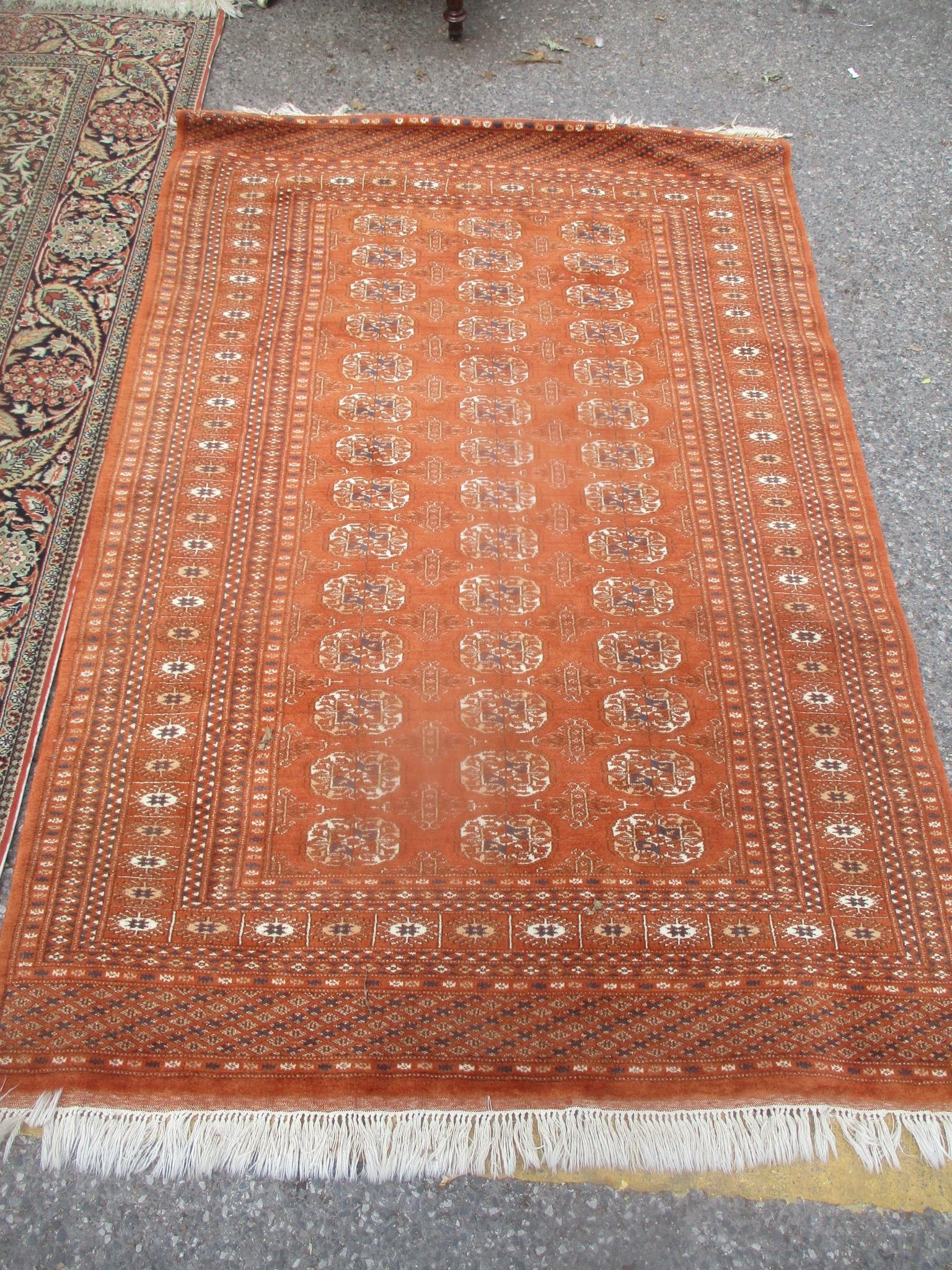 Two Turkish rugs to include a red ground elephant foot motif rug, 190 x 127cm and a floral rug - Image 2 of 3