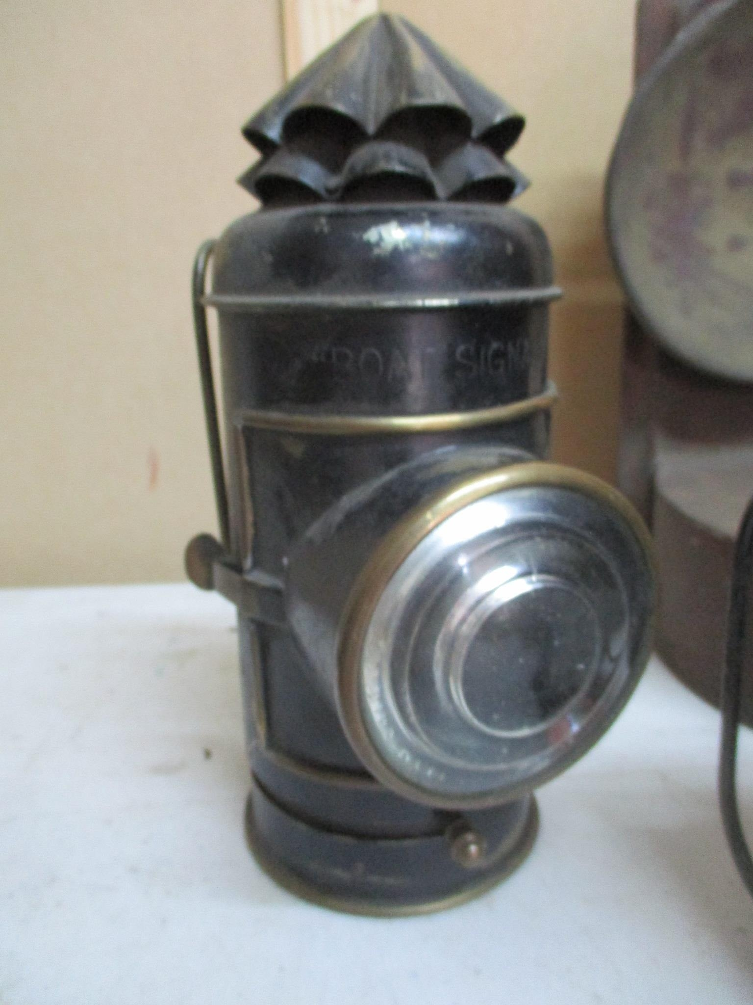 A group of 19th century and later lamps to include a Perko boat signal lamp by the Perkins Marine - Image 2 of 4