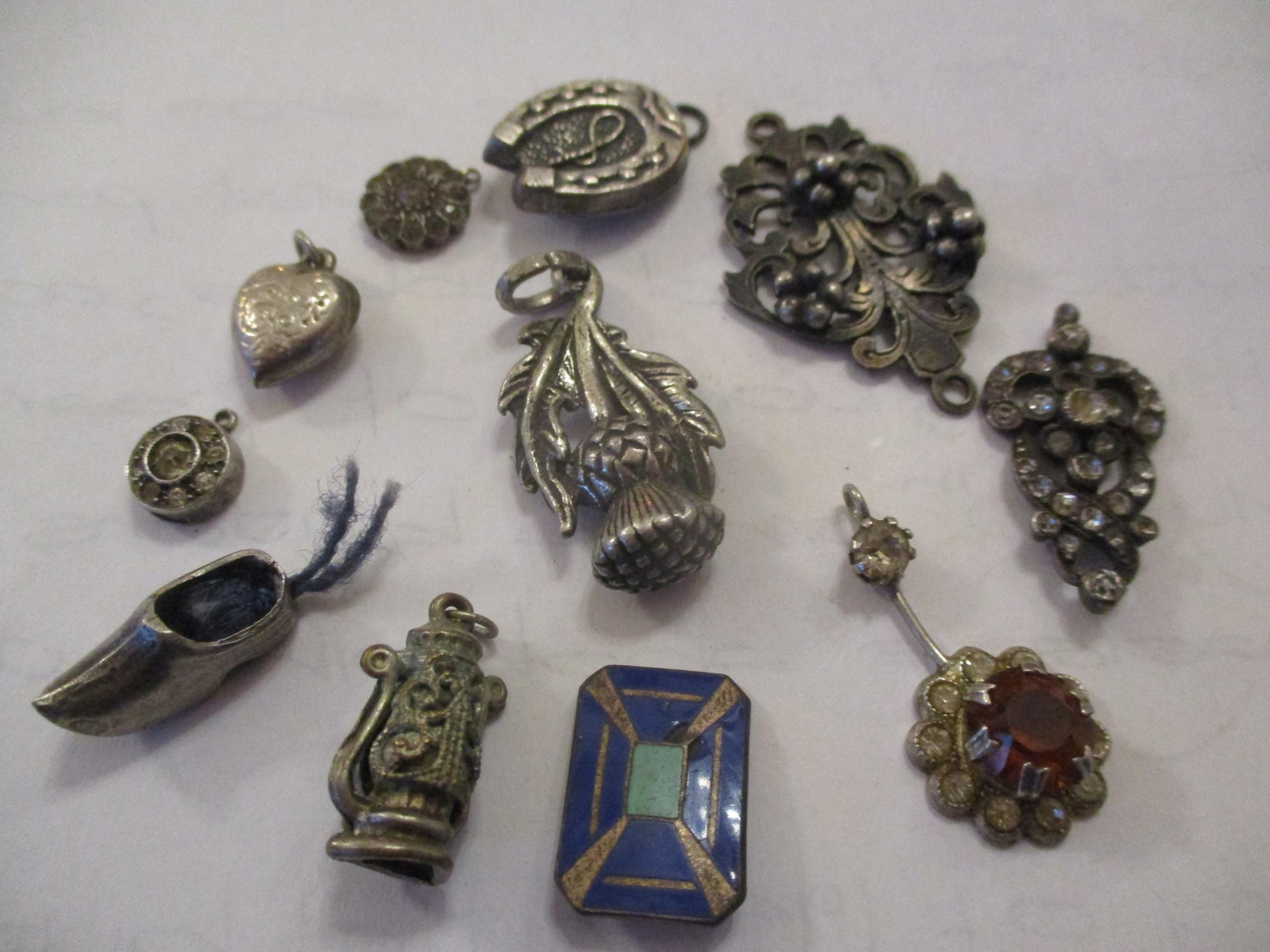 An interesting lot to include shoe buckles, silver coloured and white metal pendants, brooches, - Image 3 of 15
