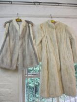 """A vintage arctic rabbit fur knee length coat with peplum sleeves, 40"""" chest x42"""" long, together with"""