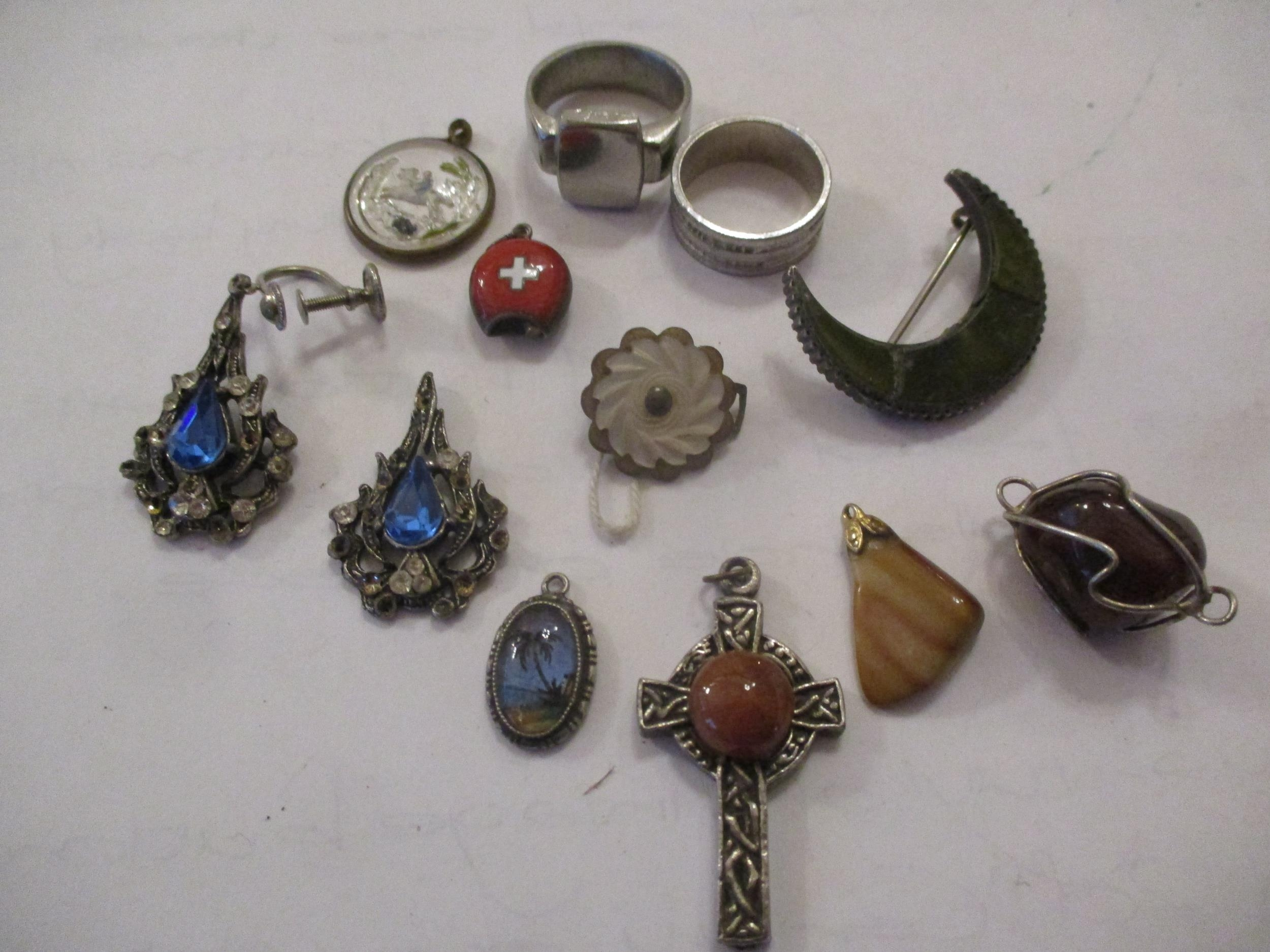An interesting lot to include shoe buckles, silver coloured and white metal pendants, brooches, - Image 5 of 15