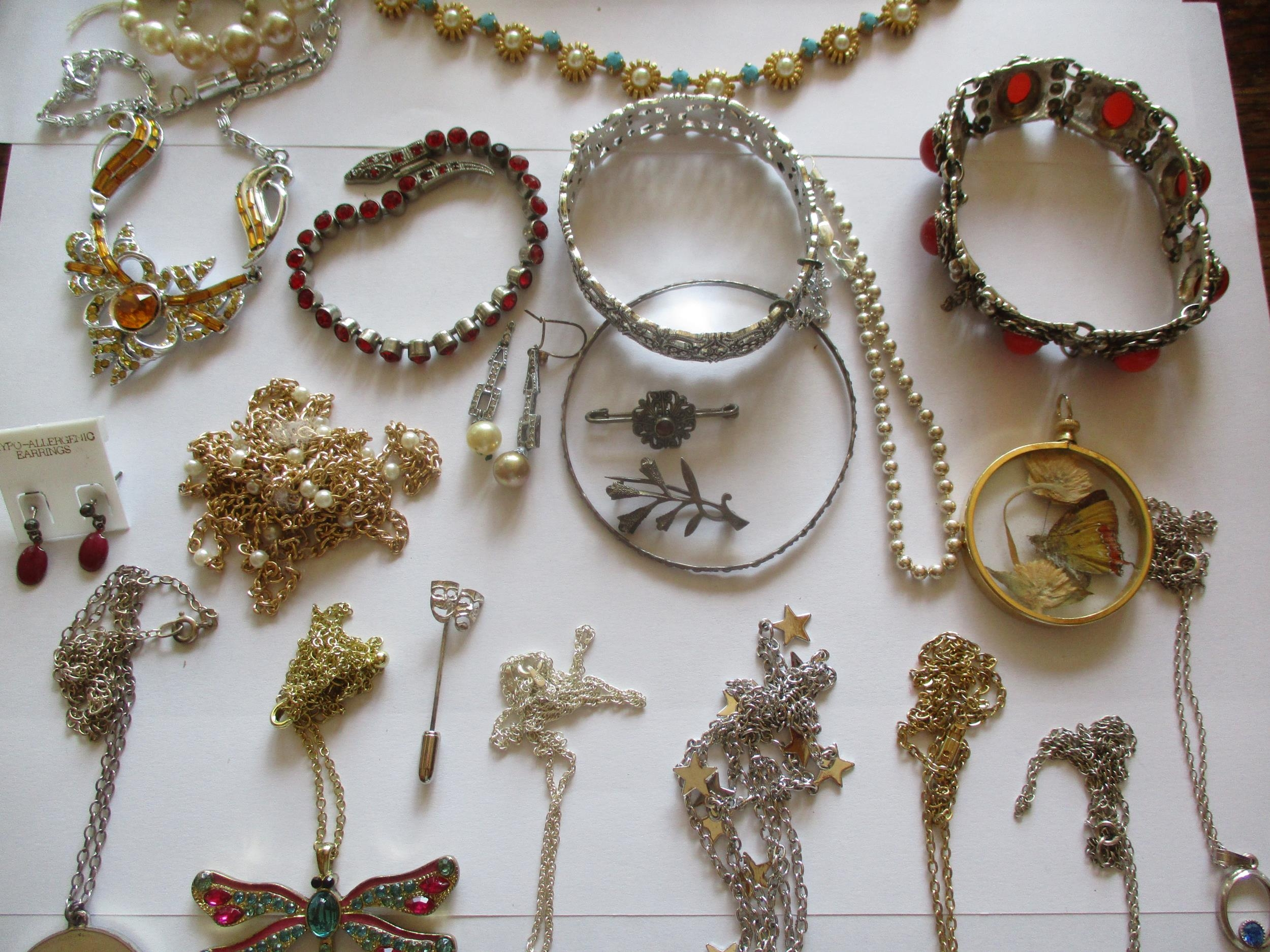 Mixed costume jewellery, mainly pendants on chains to include silver examples and a sterling - Image 3 of 8